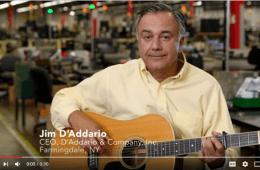 jim d'addario with a guitar, the ceo of d'addario