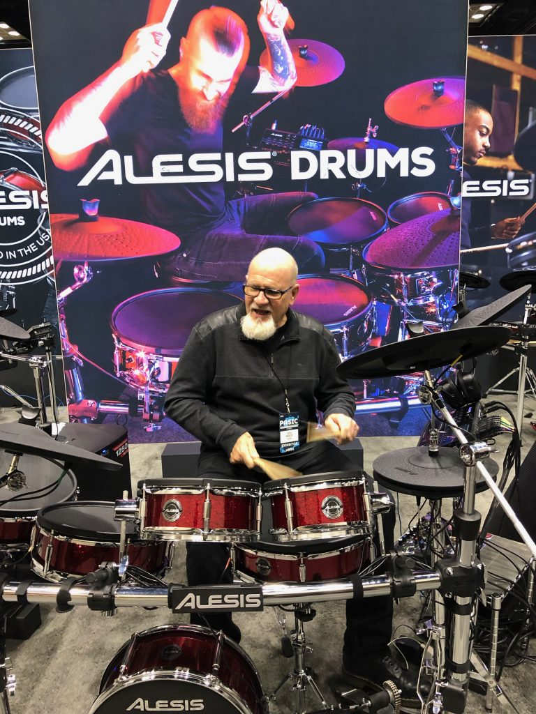 Tim Root demonstrates an Alesis Strike electronic drum set at PASIC in November 2018.