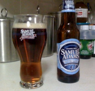 Samuel Adams Winter Lager bottle and Winter Lager poured into a Samuel Adams beer glass