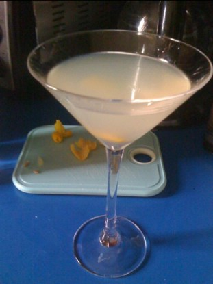 A cocktail glass containing a Kami kaze made with Cointreau
