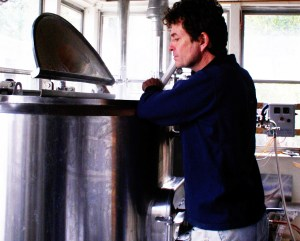 Paul Dlugokencky stirs the wort at his Blind Bat Brewery