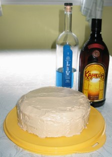 White Russian cake with LiV Vodka and Kahlúa bottles