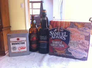 A pack of Sixpoint Brownstone, 2 bottles of Orchard Gate Gold JK's Scrumpy Hard Cider, a bottle of Samuel Adams Stony Brook Red, and a case of Samuel Adams Harvest Collection 2012