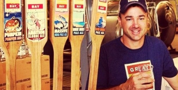 Rick Sobotka of Great South Bay Brewing stands by five taps of his beer.