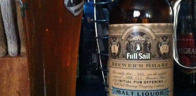 A pint of Full Sail Big Daddy J's Malt Liquor next to a bottle of the same.