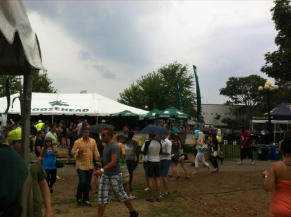 Several people walk by the Moosehead tent on an overcast day at Toronto's Festival of Beer 2013.