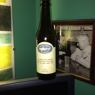12 oz bottle of Dogfish Head Piercing Pils