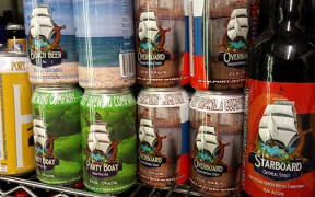 Cans of Port Jeff Brewing Party Boat Session IPA, Beach Beer, and Overboard