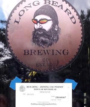 Long Beard Building Permit sign on door