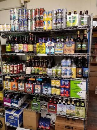 Six racks of cans and bottles of Long Island local beer at Bellport Cold Beer and Soda, in Bellport NY
