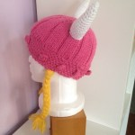 Knitted and crocheted pink viking hat