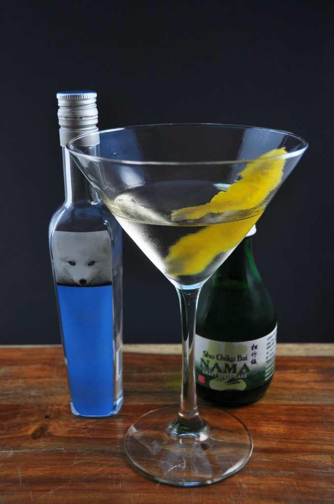 Foxy Bay Cocktail next to sake bottle and vodka mini bottle