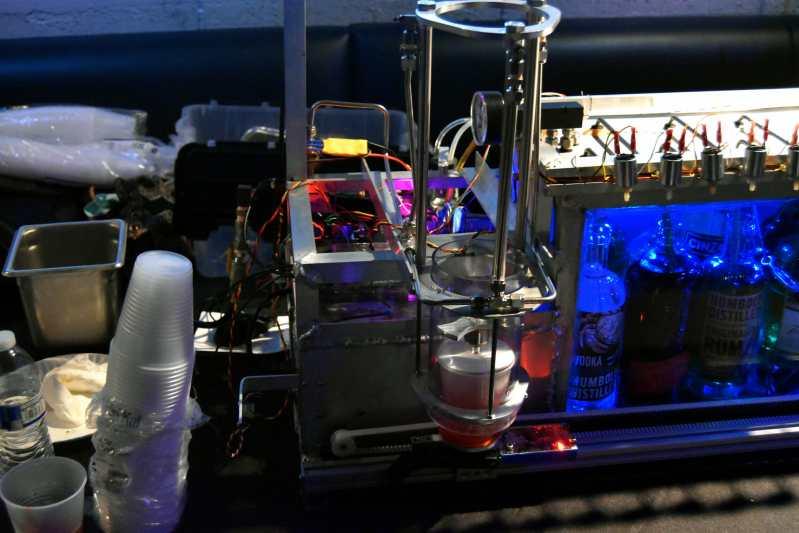 Cocktail Robot next to set of blue bottles