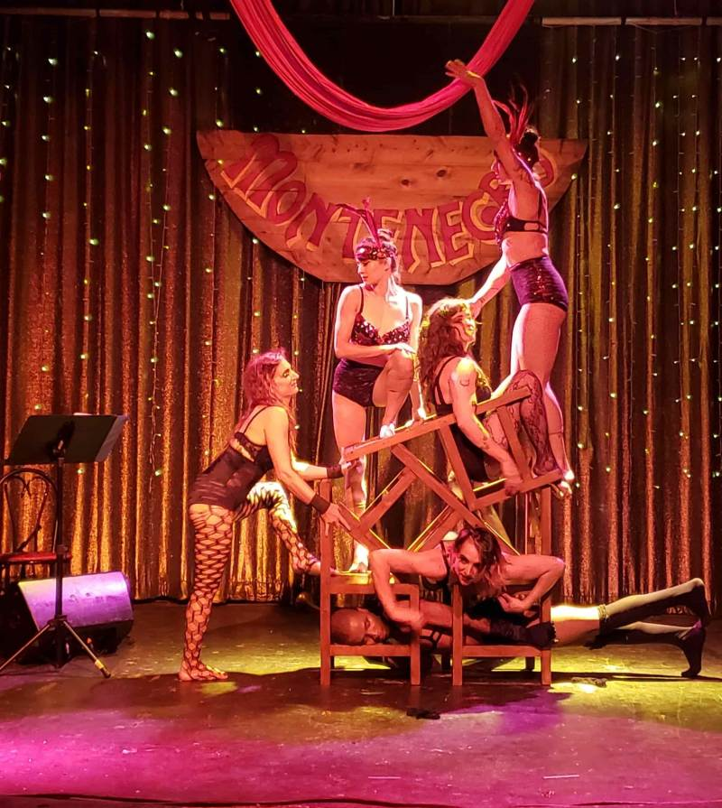 Burlesque dancers with chairs performing