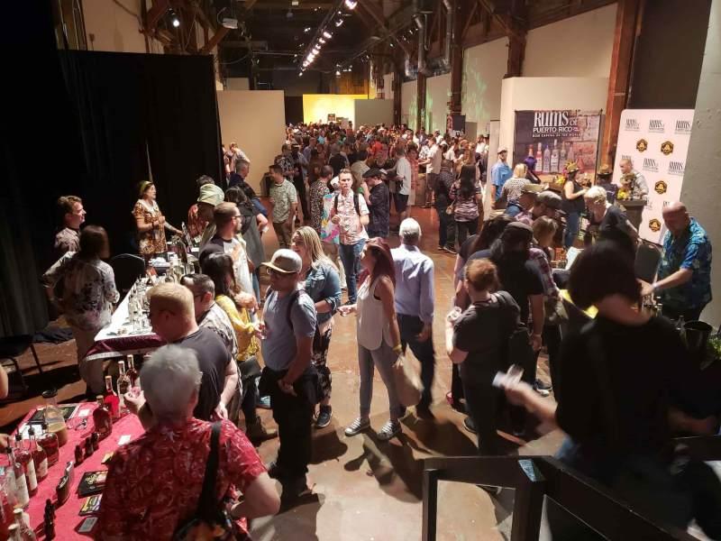 Many people in between rum displays