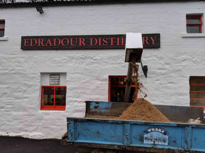 Mash being ejected from distillery into dump truck