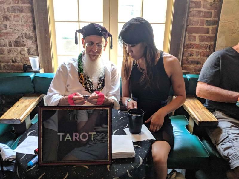 Man and woman reading tarot cards