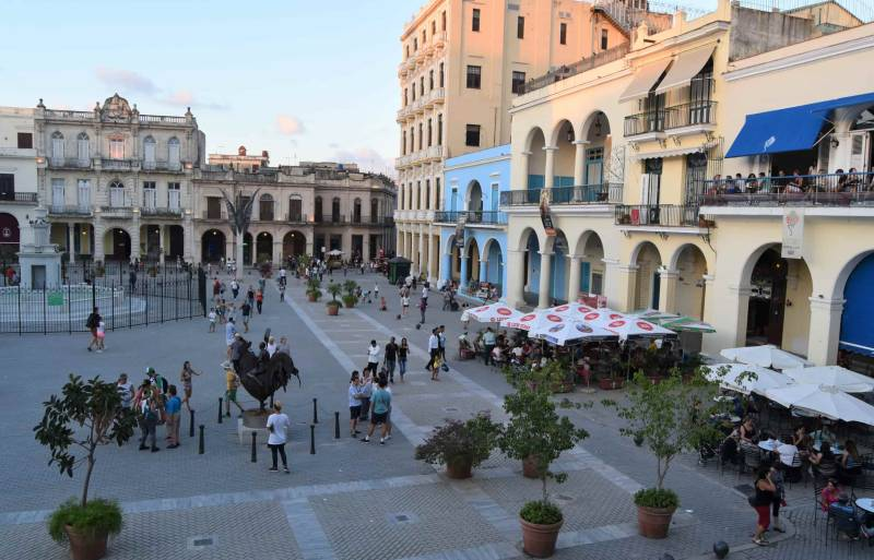 Square with colonial buildings and many people