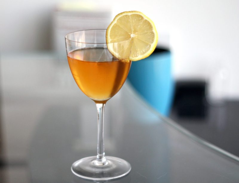 Groovy appeal cocktail with lemon wheel garnish