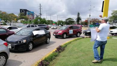 Photo of En cientos de autos, habitantes de Cancún protestan contra AMLO
