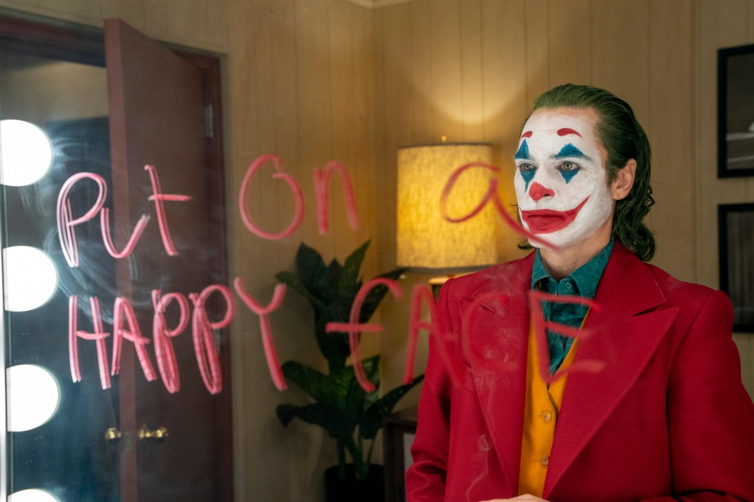 Image of the Joker in front of the mirror