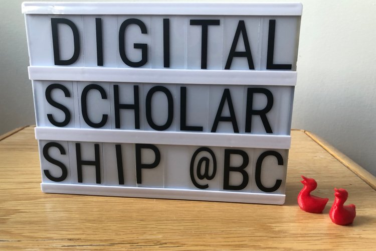"letterboard that spells out ""digital scholarship @BC"" with red, 3d printed ducks in the foreground"