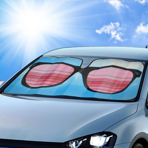 This is a picture of a car with a windshield sun deflector looking like a shade. Shades keep you looking cool - and your car cooler.