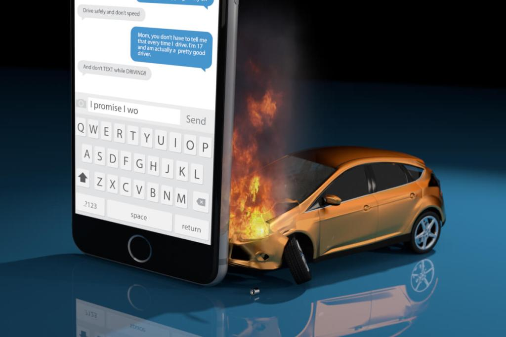 A car is on fire because it crashed into a smart phone. This picture reminds us that we should not text and drive.