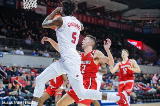 SMU guard Emmanuael Bandoumel is fouled on his way to the basket during the first half of the game between Southern Methodist University and Hartford on November 27, 2019 at Moody Coliseum in Dallas, Tx. (Photo by Joseph Barringhaus/Dallas Sports Fanatics)