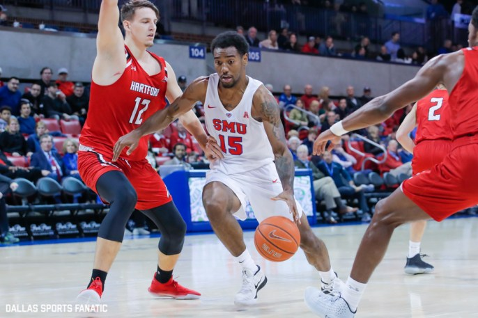 SMU forward Isiaha Mike dribbles through traffic during the first half of the game between Southern Methodist University and Hartford on November 27, 2019 at Moody Coliseum in Dallas, Tx. (Photo by Joseph Barringhaus/Dallas Sports Fanatics)