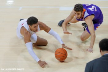 SMU forward Everett Ray reaches for the ball on the ground during the second half of the game against Northwestern on December 3, 2019 at Moody Coliseum in Dallas, Tx. (Photo by Joseph Barringhaus/Dallas Sports Fanatic)