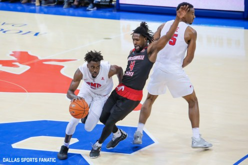 SMU guard Emmanuel Bandoumel dribbles around Jacksonville State guard Ty Hudson during the game between SMU and Jacksonville State on November 5, 2019 at Moody Coliseum in Dallas, Tx. (Photo by Joseph Barringhaus/Dallas Sports Fanatic)