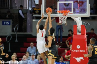 SMU forward Feron Hunt (1) is blocked by Wichita State center Jaime Echenique (21) during the American Athletic Conference college basketball game between the SMU Mustangs and the Wichita State Shockers on March 1, 2020 at Moody Coliseum in Dallas, Texas. (Photo by Joseph Barringhaus/Dallas Sports Fanatic)