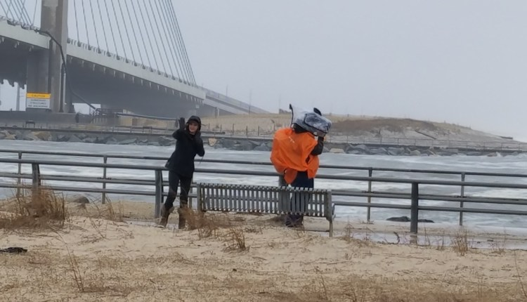Madeleine Overturf and her cameraman braving the elements and crashing waves at the Inlet today.