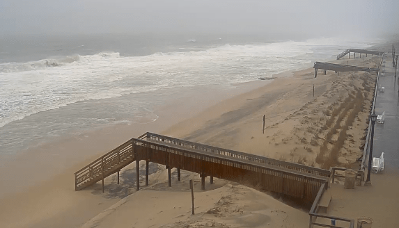 In the background you can see the stairs that fell  off the dune crossing in Bethany Beach.