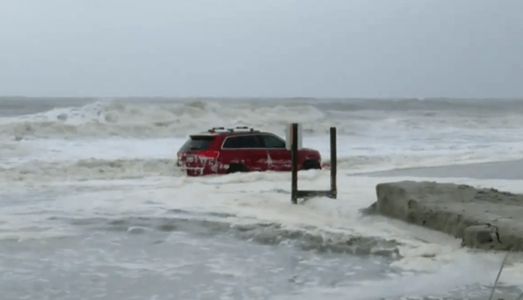 The jeep was getting pummeled in the surf.  Everyone watching live to see what happened.