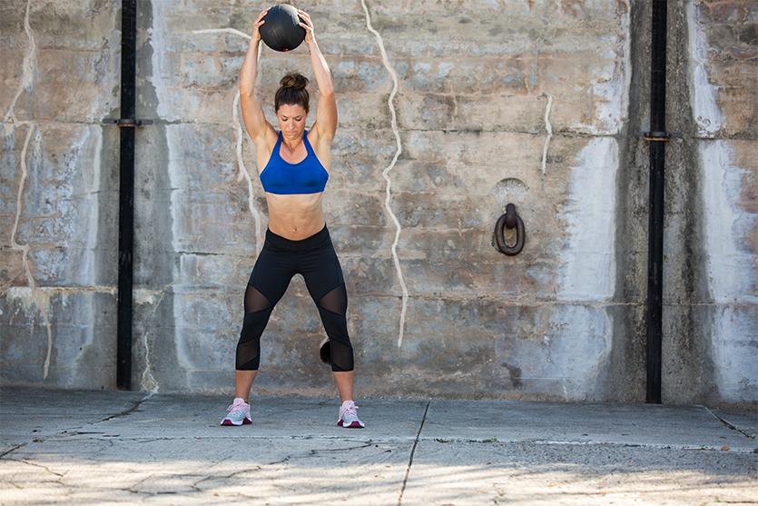 woman using slam ball