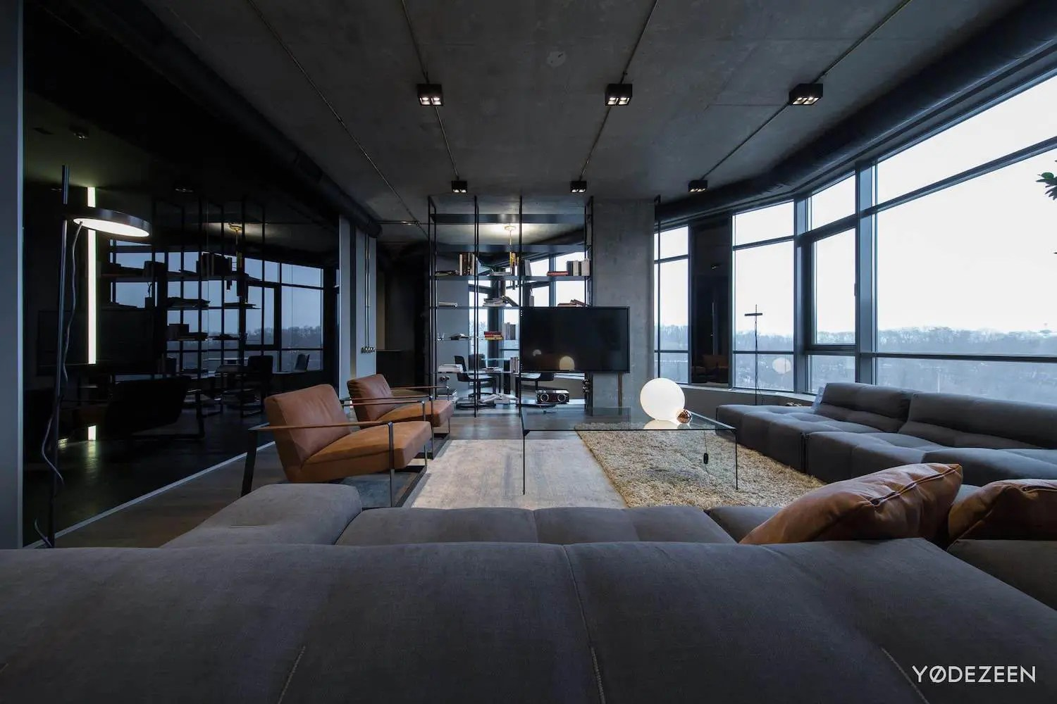 Apartment In Concrete, Dark Surfaces And Dramatic Lighting