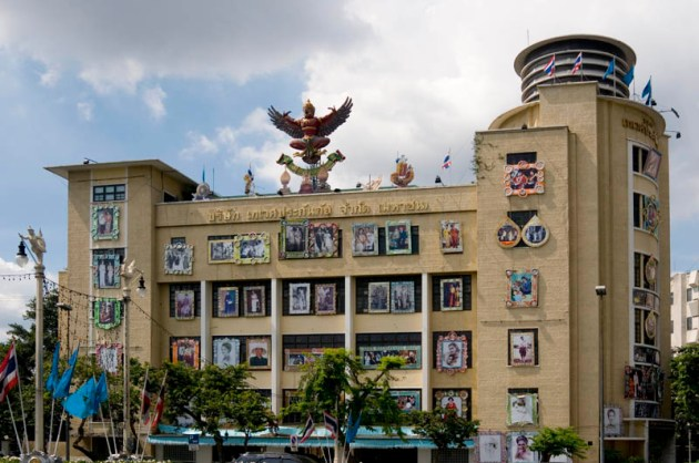 Queen's Birthday displays adorn a public building in Bangkok, Thailand