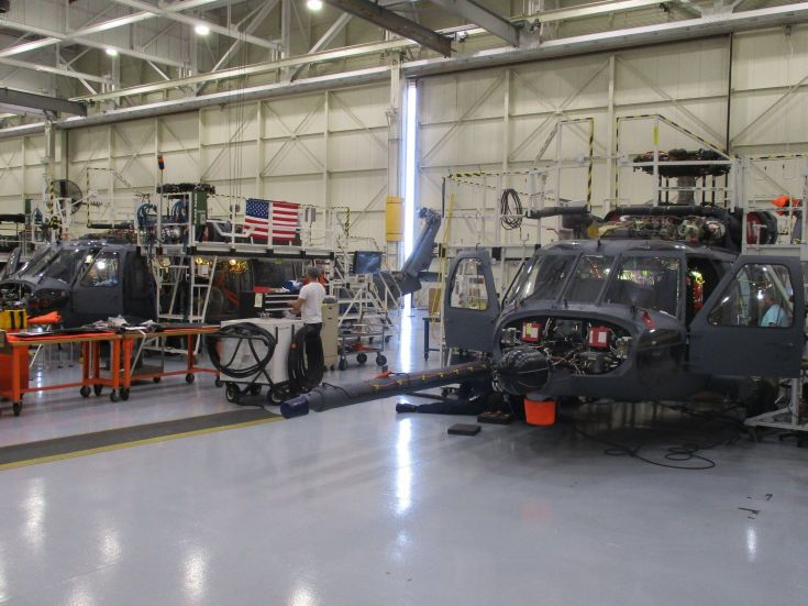 helicopters being built in a factory