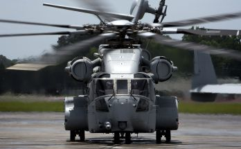 front view of a large helicopter sitting on tarmac