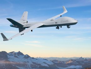 unmanned aerial vehicle flying above snow-capped mountains