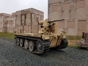 tracked unmanned vehicle with a mounted machine gun and sensors