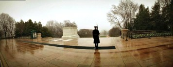 A panoramic view of a sentinel watching over the Tomb of the Unknowns.