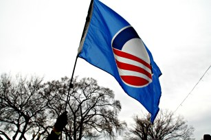 An Obama supporter waves a flag in the crowd after the inaugural ceremony.