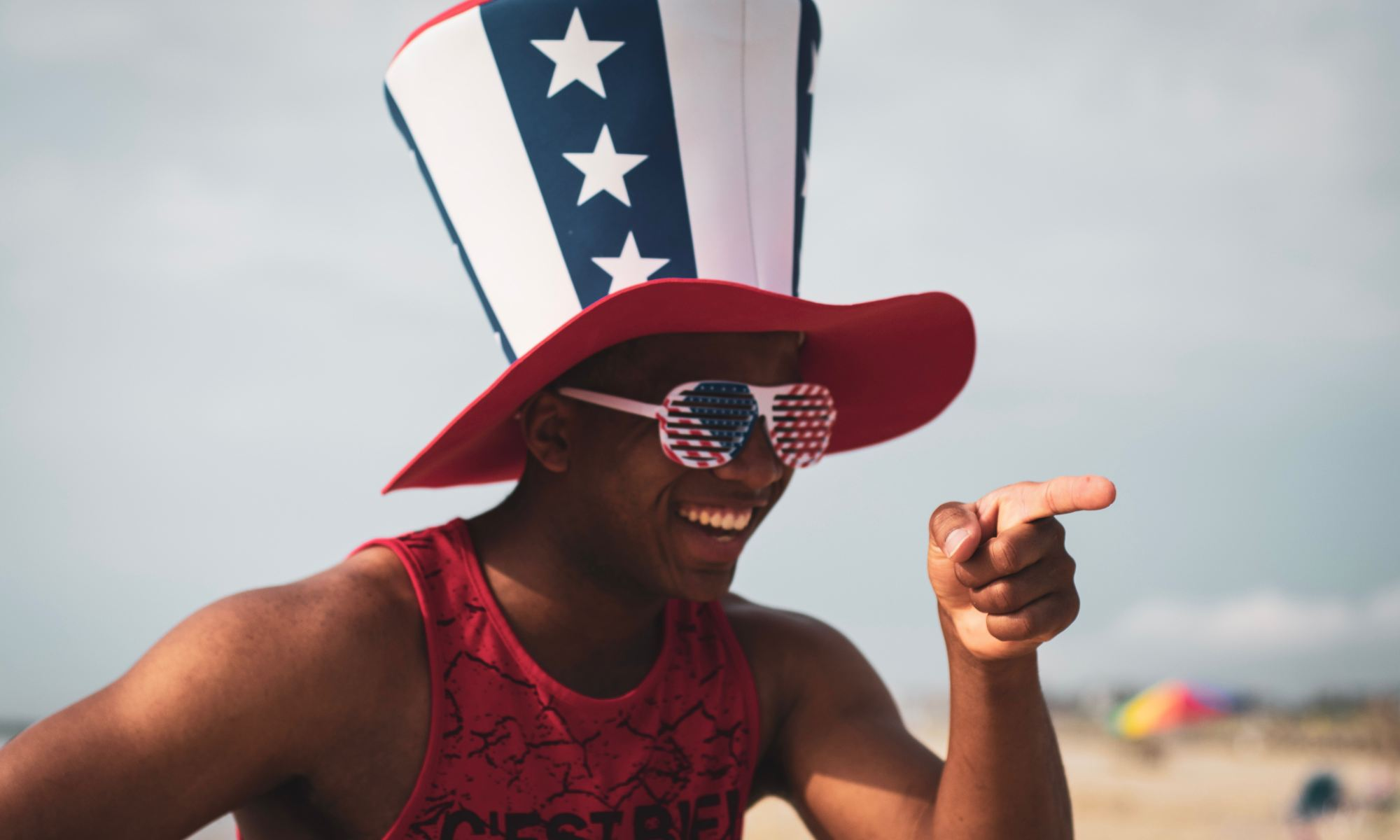 Young black man smiling and enjoying independence day