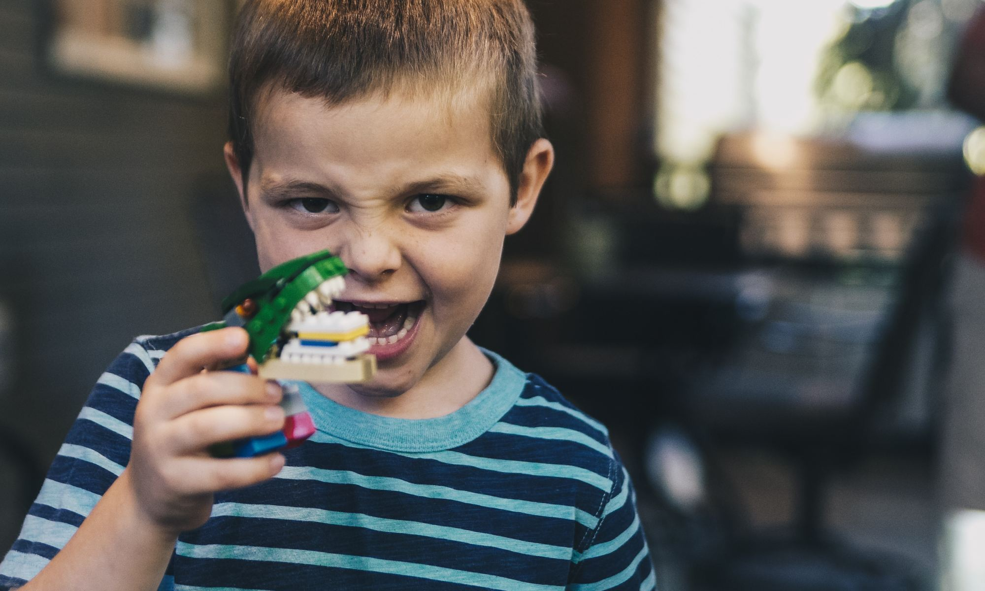 Boy with social communication disorder holding toy