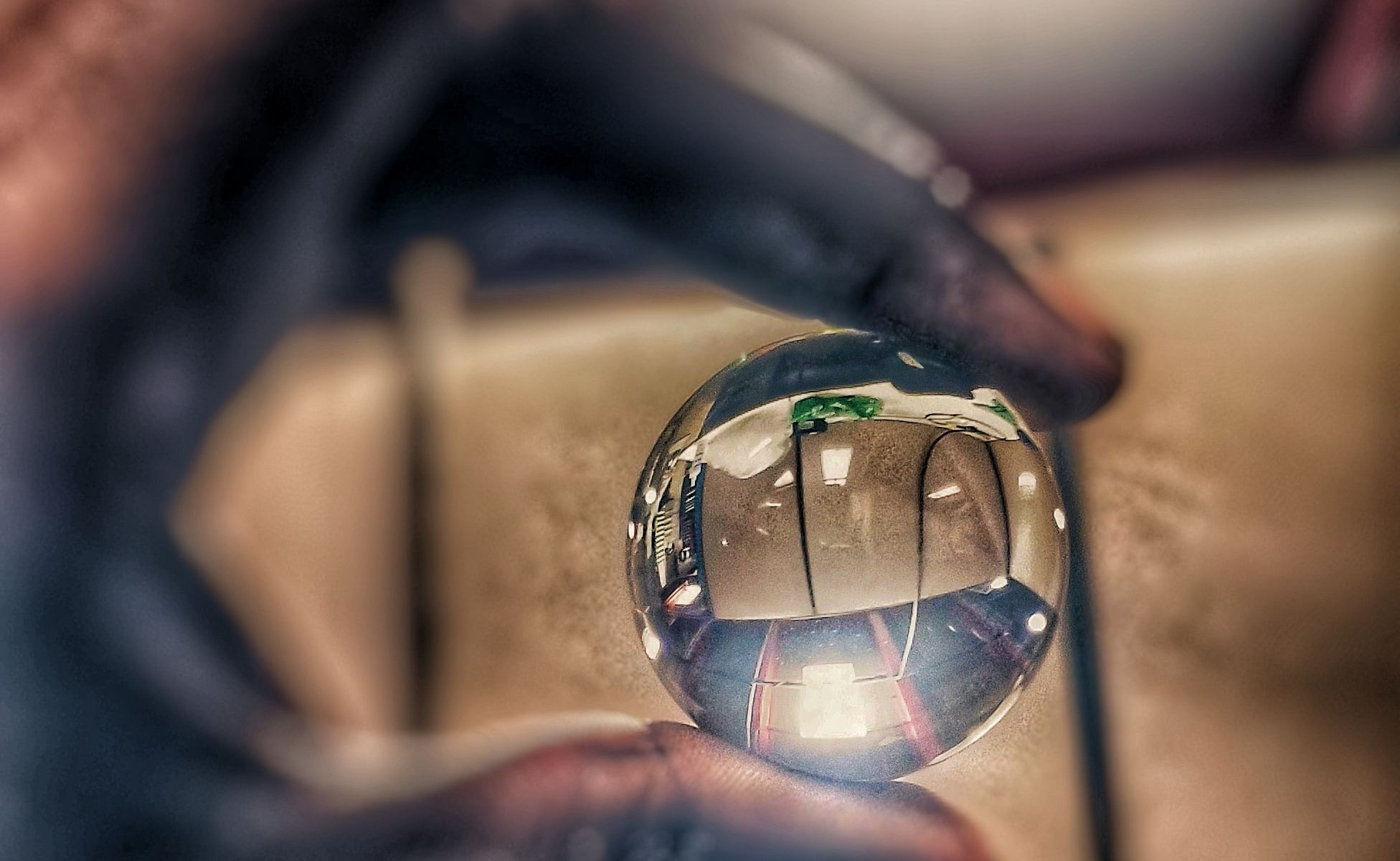 Hand holding round clear glass