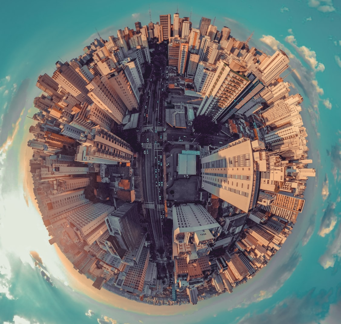 Fish-eye photography of city and sky