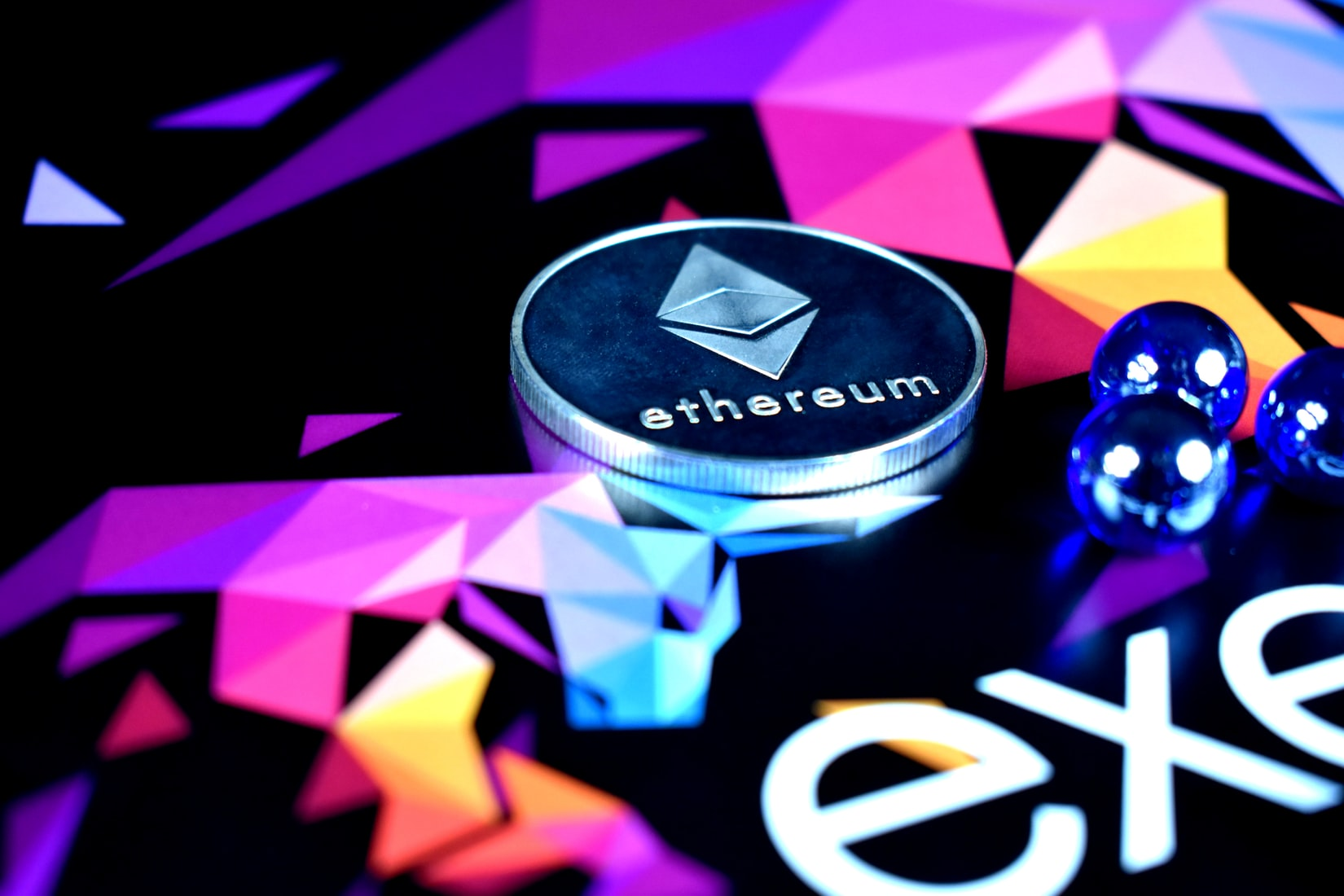 Ethereum coin with logo on purple and black background